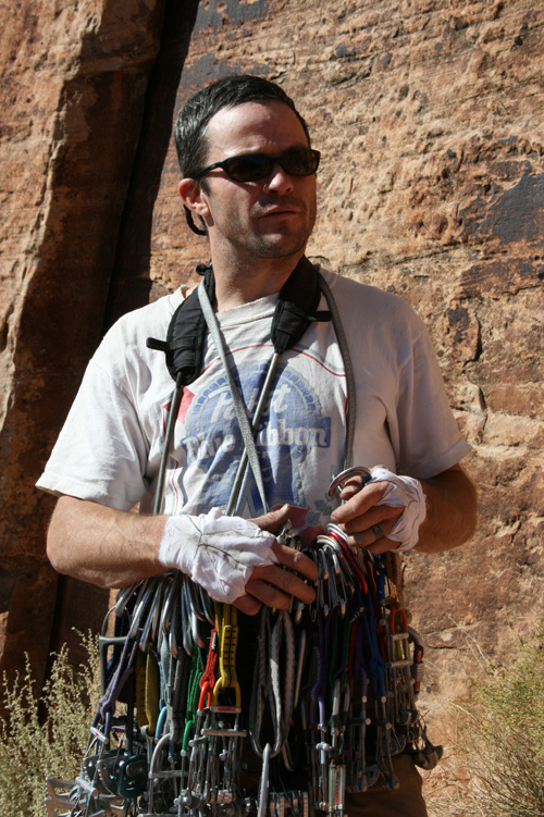 Kelly Cordes sorts his rack of cams at Indian Creek, 216 kb