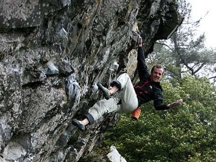 Dave MacLeod climbing at Hylldrem in pouring rain, 59 kb