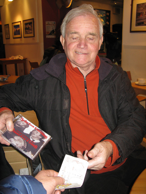 Dennis Gray, like a market trader, was hawking his latest CD, The Bar Room Mountaineers., 119 kb