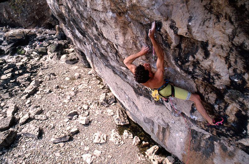Jerry climbing his route Liquid Ambar (F8c/+)  at Lower Pen Trwyn in 1990. Photo credit: Kurt Albert., 189 kb