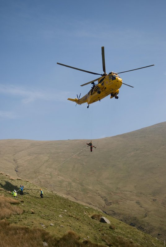 A stretcher being winched in to a SeaKing helicopter, 50 kb