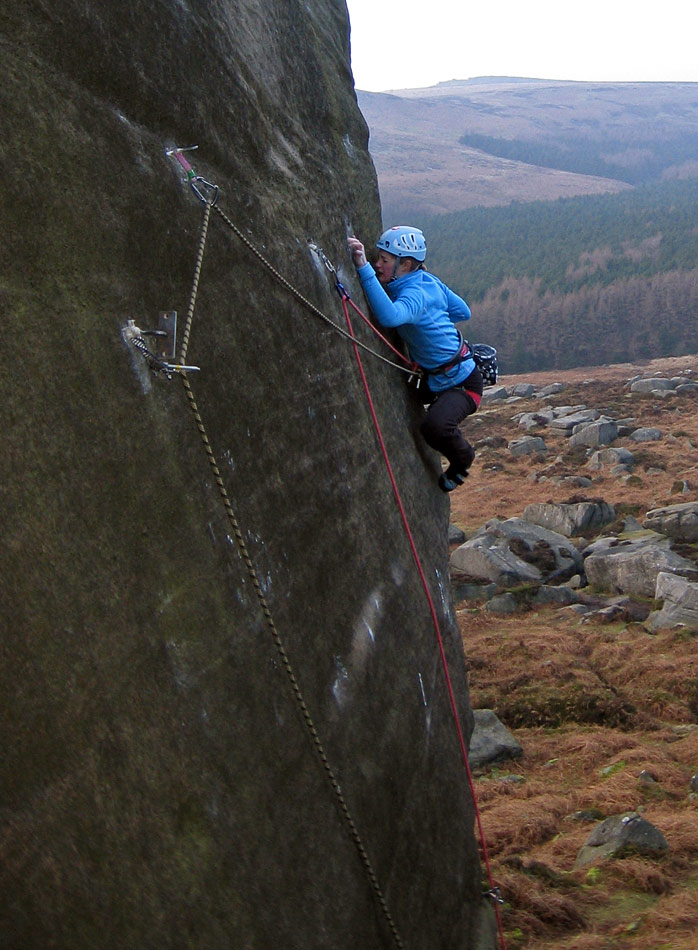 Katy Whittaker climbing Braille Trail at Burbage, 155 kb