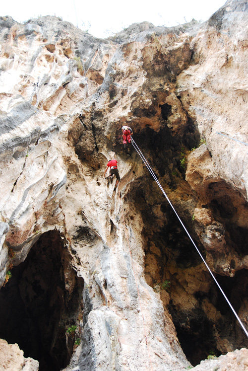 Misha Gopal redpointing a F7a pillar with Steve dangling next to him, 212 kb