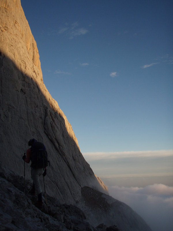 Morning sun on the S.Face of Naranjo de Bulnes. Clare Mason at the base of Naranjo de Bulnes at dawn, 49 kb