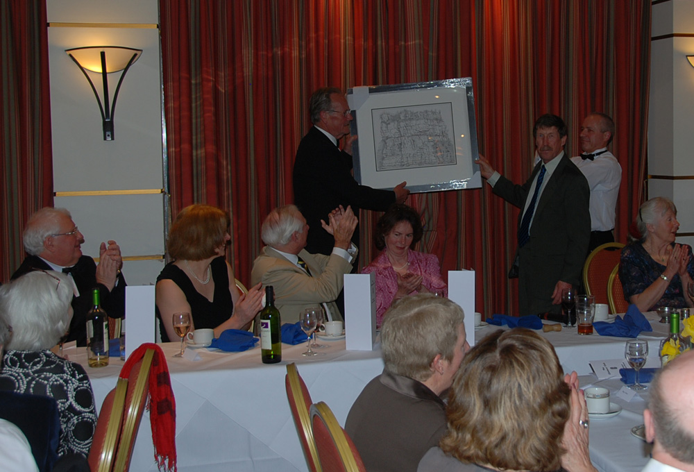 The Hon. President Smiler Cuthbertson presents John Willson with an original Phil Gibson drawing of GO Wall, Wintours Leap., 211 kb