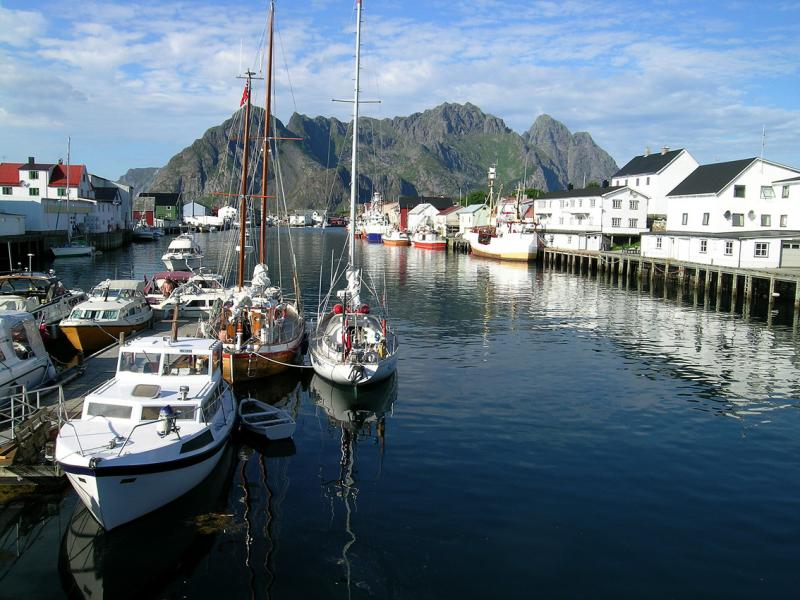 Henningsvaer, the centre of Lofoten climbing. The pyramid of Vågakallen (943m) is prominent on the right., 83 kb