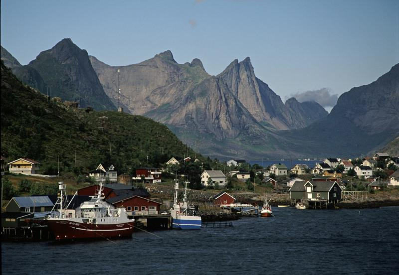 Rein, south Lofoten with the dramatic Breiflogtinden (750m) in the distance. This huge pillar is home to two routes., 61 kb