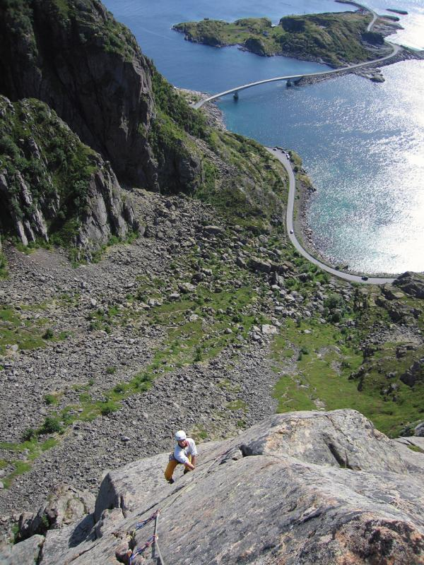 Looking down the top pitch of Lundeklubben (N6) (Puffin Club) (E1 5b) with the Henningsvaer bridges in the background. , 123 kb