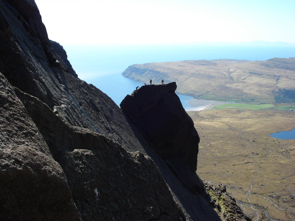 Looking across to climbers on the Cioch from Shangri La, 130 kb