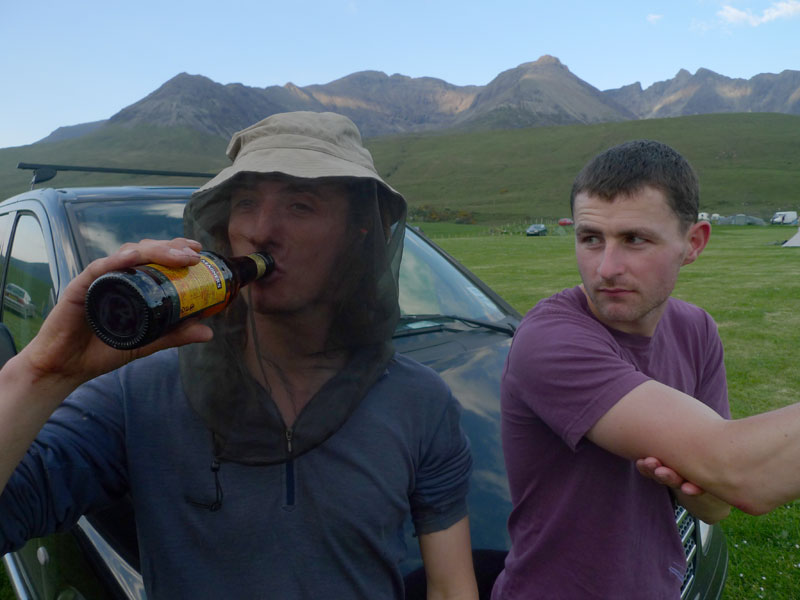 Dave Thornley, down from the Ridge chugs on a beer whilst protected by his Bug Bucket from the evil Glenbrittle midges., 67 kb