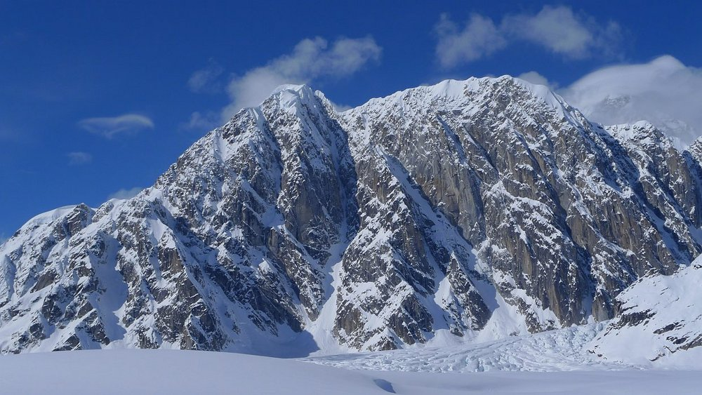 The previously unclimbed 1500m east face of Peak 11,300. Night of the Raging Goose takes the central couloir line., 148 kb