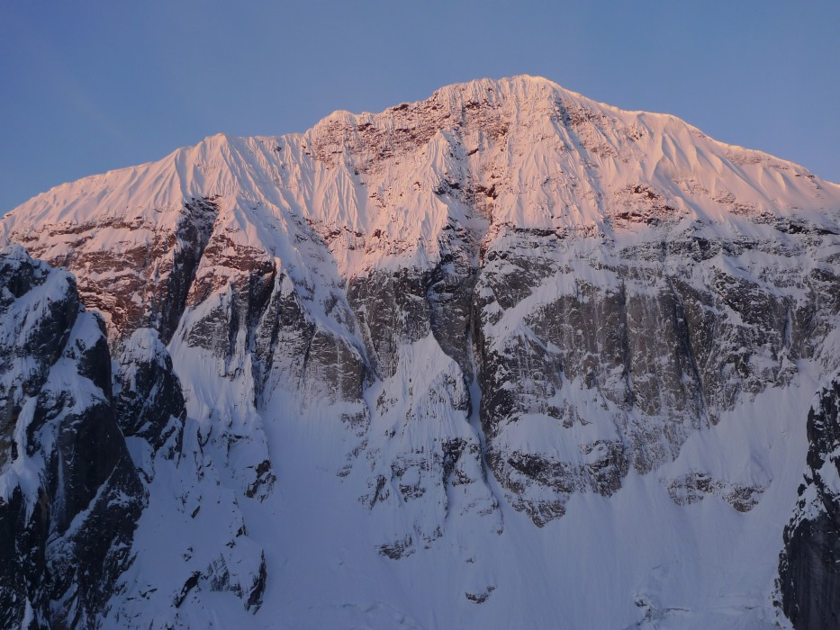 The 1200m north face of Mt Church . Amazing Grace  takes the ice streaks through the rockband just left-of-centre, 180 kb