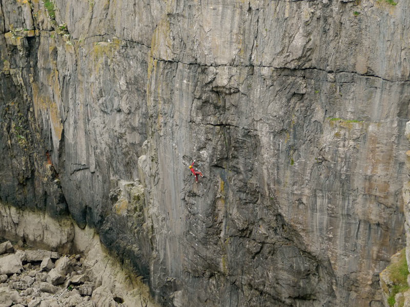 Erik Svab making the third ascent of Point Blank (E8) in Stennis Ford, Pembroke., 136 kb