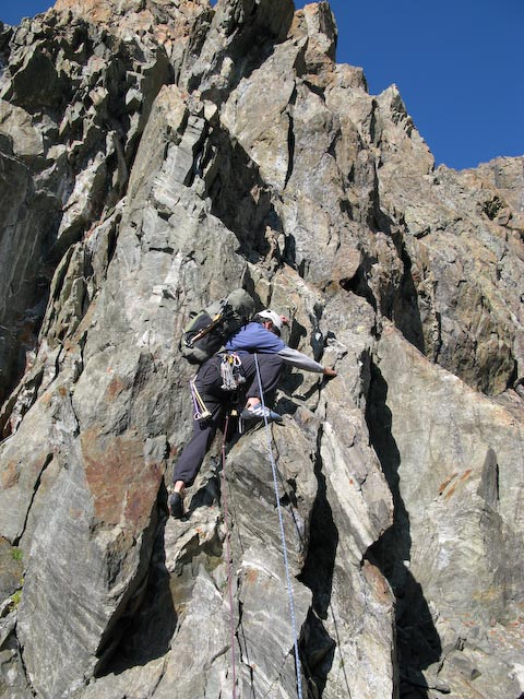 Duncan Tunstall climbing the ridge as the rock improves on day 2, 128 kb