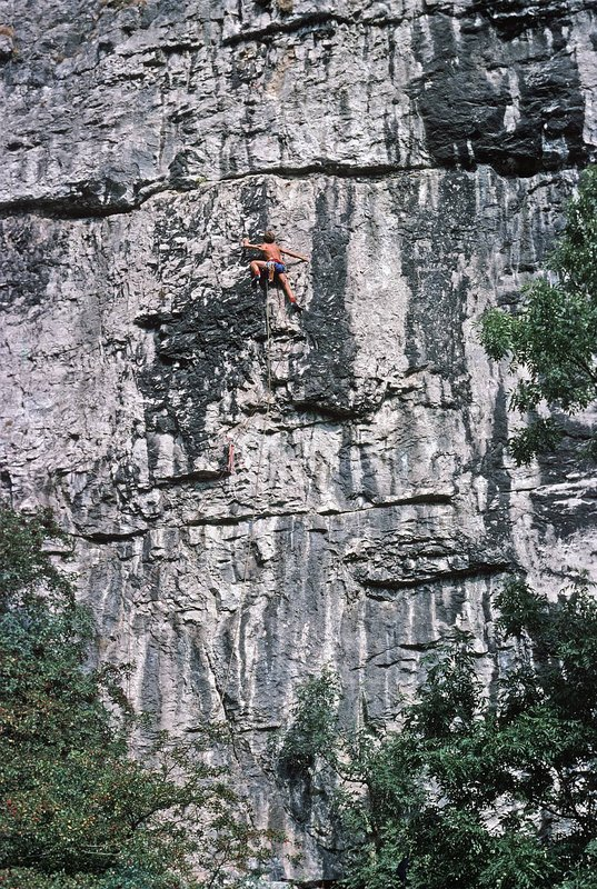Ron Fawcett on first free ascent (one peg) of the old aid route Hubris at Raven Tor., 201 kb