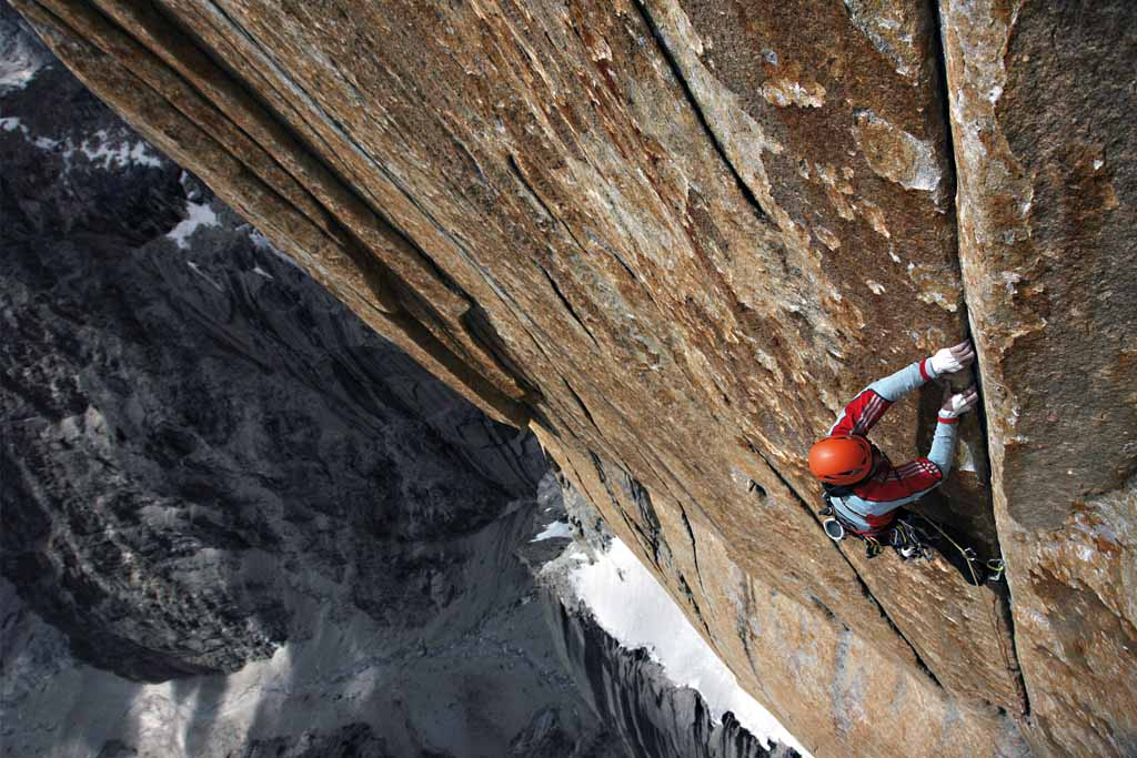 The start of the steep central part of the route is an slightly overhanging finger-crack.  Alexander climbing., 123 kb