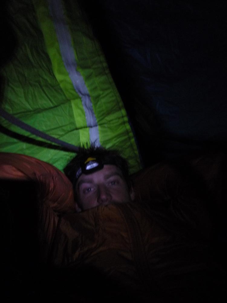 Jack Geldard portaledging in his 'Himalya Hoody' high on the Hallucinogen Wall, Black Canyon, 125 kb