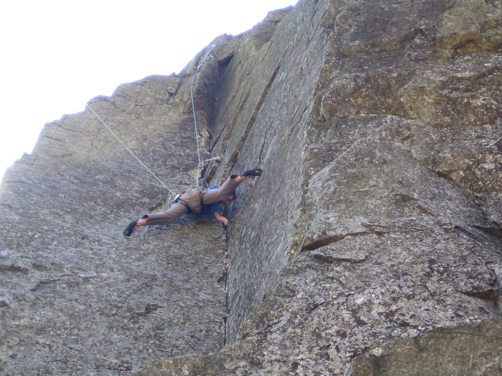 Wes Hunter stretching a youthful groin on one of the harder E4 routes around.Lost Horizons on the East Buttress., 201 kb
