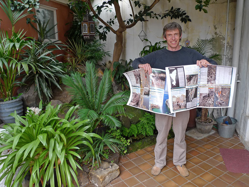 Alan James in the jungle of modern climbing media with the proofs of the Pembroke Rockfax, 151 kb