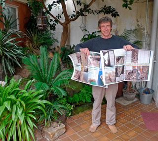 Alan James in the jungle of modern climbing media with the proofs of the Pembroke Rockfax, 43 kb