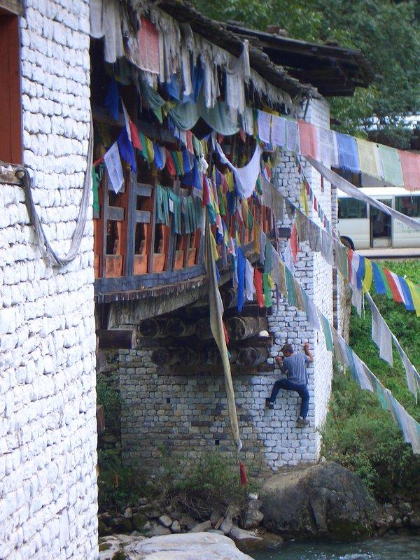 Not actually buildering, conducting a bridge inspection in Bhutan, 131 kb