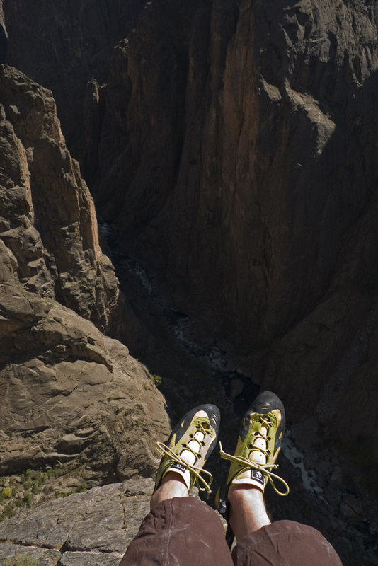 The author wearing a fairly stiff pair of shoes slightly bigger than his normal size, on a long route in the Black Canyon, USA, 88 kb