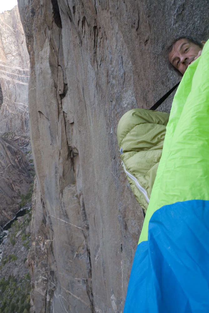 Ian Wilson peeking out of his portaledge on the Hallucinogen Wall, Black Canyon, 233 kb
