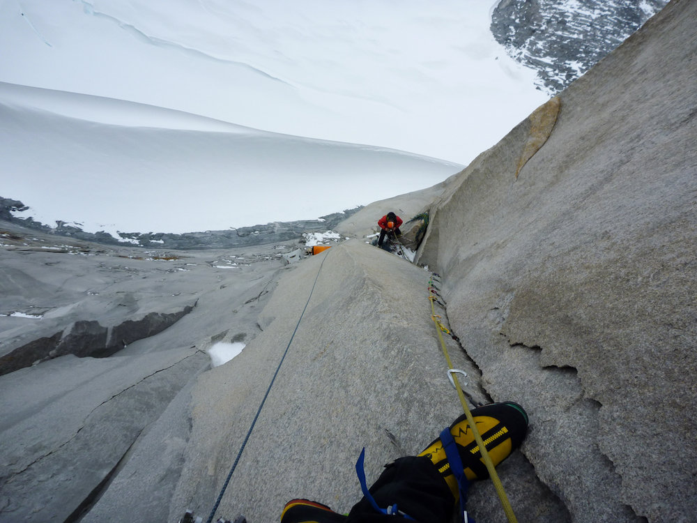 Pete Rhodes aiding pitch 14 looking down at George Ullrich on their previous expedition, 147 kb
