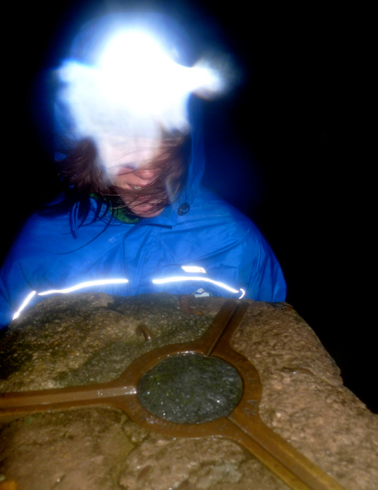 Sally Wheatley, using the TIKKA XP² at the trig point on Helvellyn during a dark and stormy night in December., 190 kb