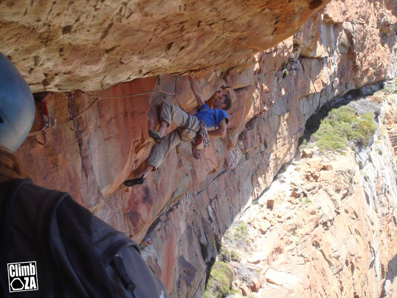 Dave Birkett chalking up on the crux roof of Remote Control, 101 kb