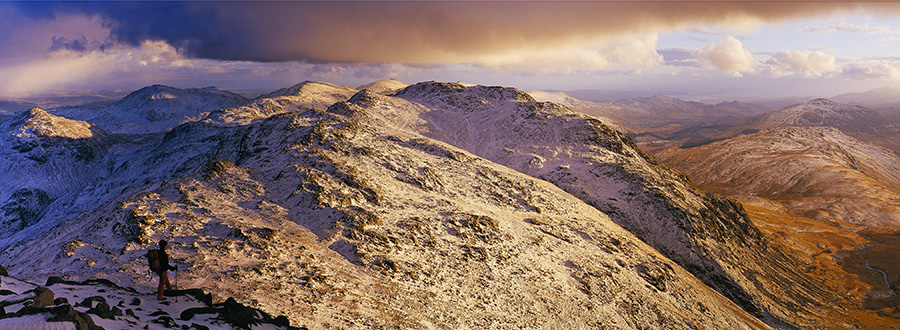 Valerie Le Clerc takes in the wild conditions over CRinkle Crags, Coniston and Wetherlam while en-route to Bowfell., 205 kb