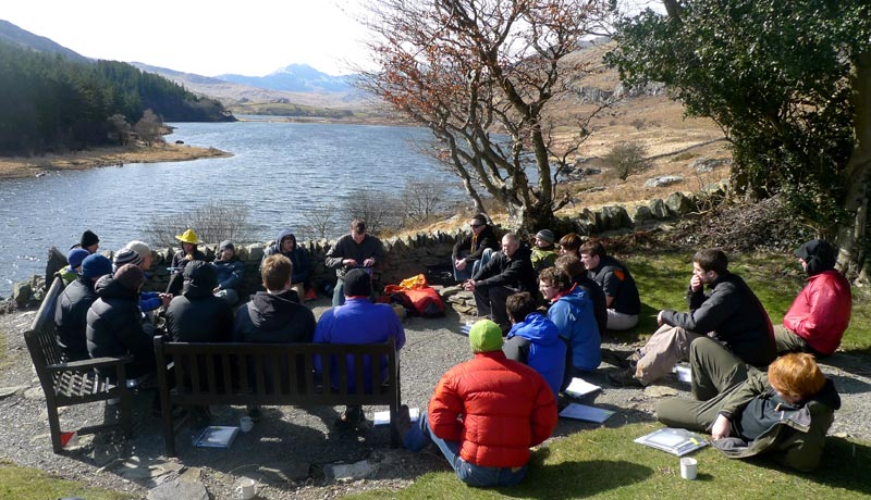 The Plas y Brenin grounds provide a lovely backdrop for talking gear (I'm in the fetching yellow Ortlieb hat)., 102 kb