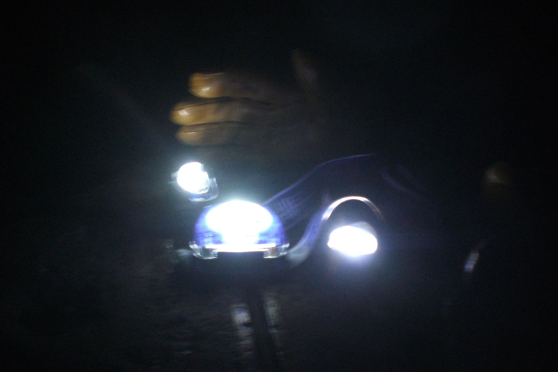 Three head torches on a Trig Point: the brightest is the TIKKA XP®²., 93 kb