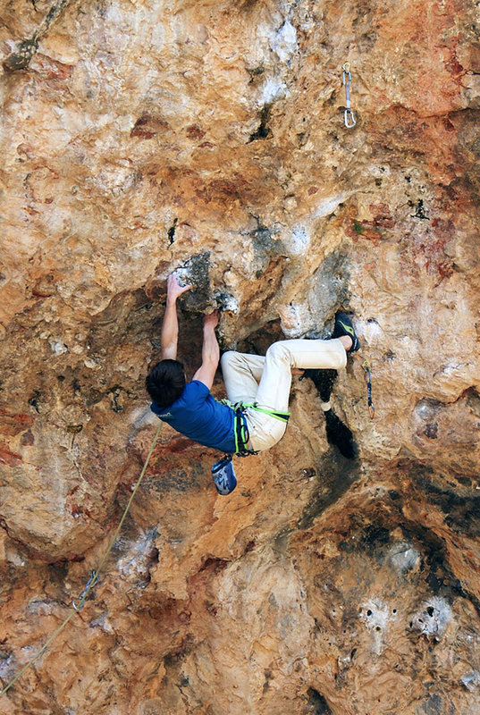 Young Jonny Stocking contorts through the crux on  Rollito Sharma F8b+, 184 kb