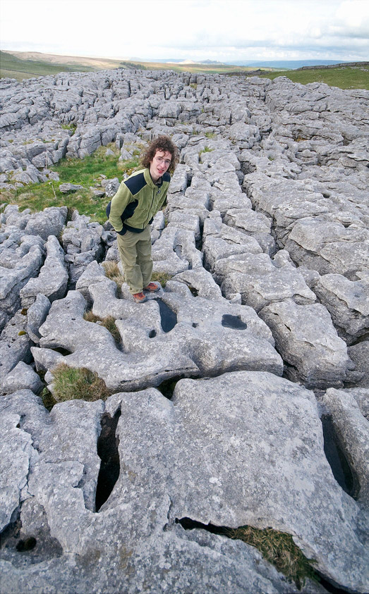 Adam Ondra exploring the deeply eroded limestone pavement atop Malham Cove in Yorkshire, 213 kb