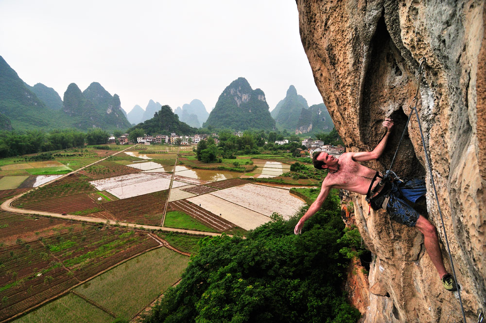 Hugh on the last moves of Todd Skinners nameless route, 7b, Banyan Tree, Yangshuo, China, 235 kb