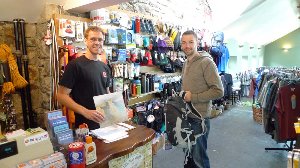 Jon Grigson at Joe Brown's Pen y Pass Shop visited by Jake Wiid from Osprey., 136 kb