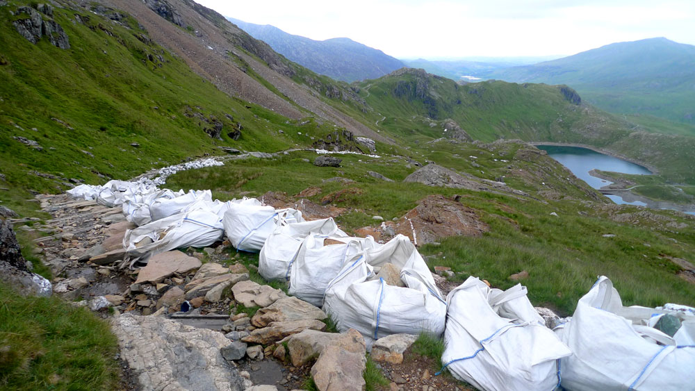 Bags of stone, helicoptered in for path restoration on the Pyg track, Snowdon, 155 kb
