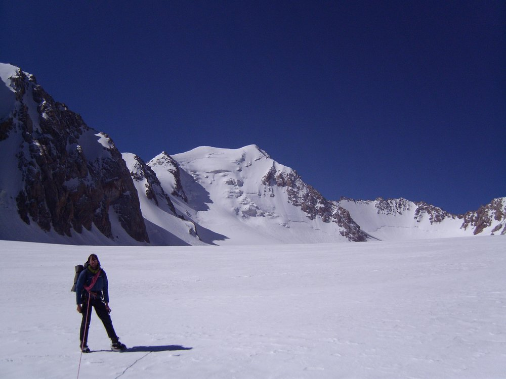 John Proctor on the glacier beneath Mur Samir (the snowy peak in the middle of the photograph).  We would have liked to have ha, 79 kb