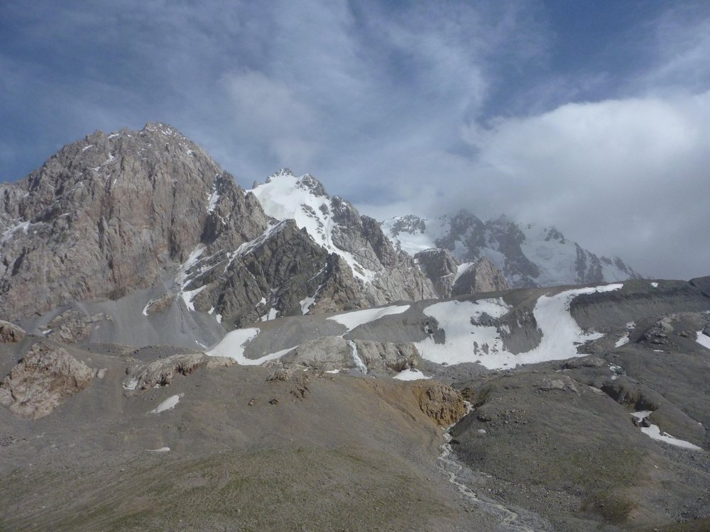 Pik Karyshkyr is the snowy peak second from the left in this photograph.  Photograph Copyright © Adam Russell., 123 kb