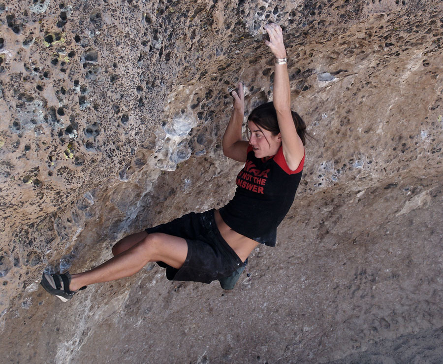 Sarah Schneider on an unrecorded problem (about V3) at The Alcove , the Sherwin Plateau., 213 kb