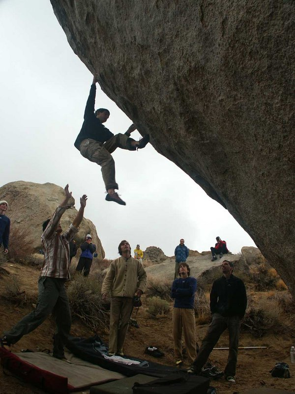 Tony Lamiche (front right) and Chris Sharma (front centre) watch boulderers attempting the Mandala V12, 92 kb