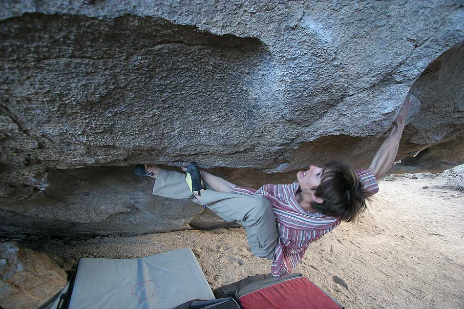Ethan Pringle in full flow on The Buttermilker V13 at the Cave area, Buttermilks main area., 126 kb