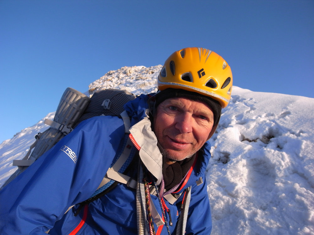 Mick Fowler on the summit of Sulamar, 140 kb