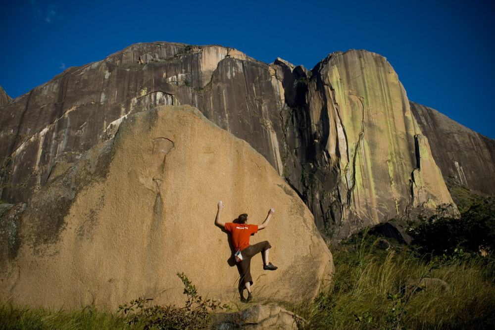 Jack Geldard on a V6 boulder beneath the tower cliff of Karambony - home of 'Tough Enough', 208 kb