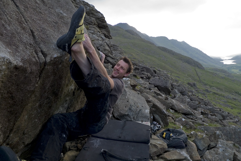 Jack Geldard on The Big Smile (7C+) in the Llanberis Pass, testing the Grit Pants., 212 kb