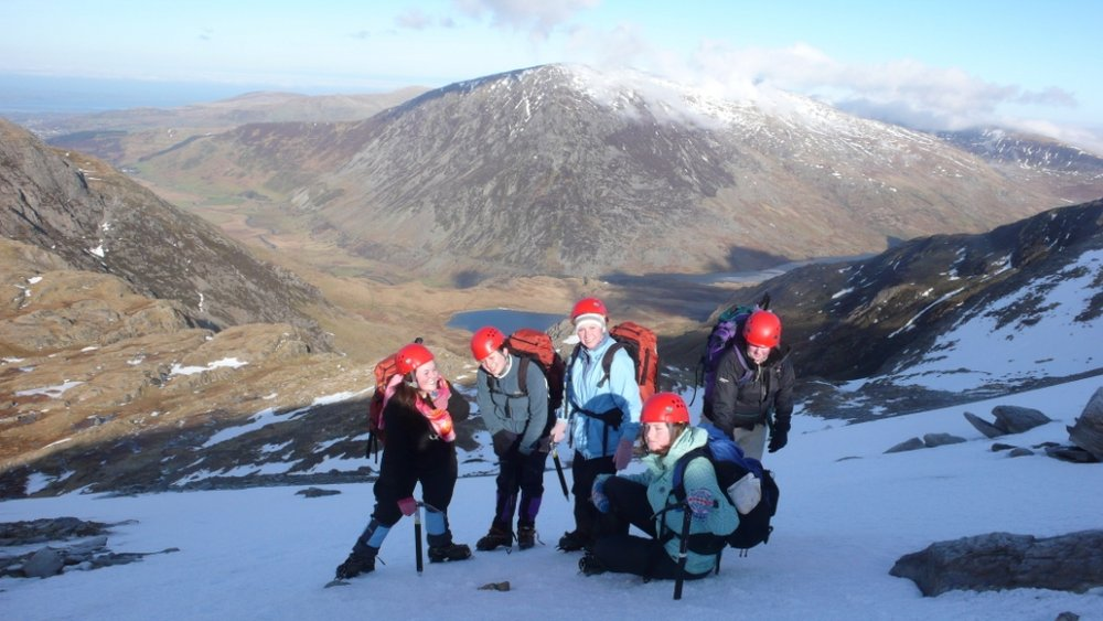 A party enjoying perfect neve on the slopes from Llyn y Cwn up to Glyder Fawr, normally a dull scree plod in summer., 100 kb