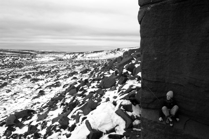 James making his young ascent of Equilibrium (E10) at Burbage, 113 kb