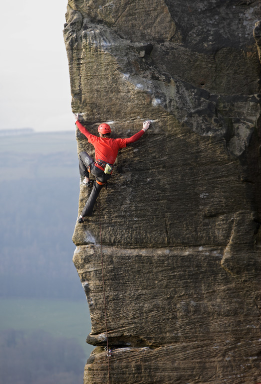 James at home on grit, onsightng End of the Affair, Curbar. This technical arete is E8., 167 kb