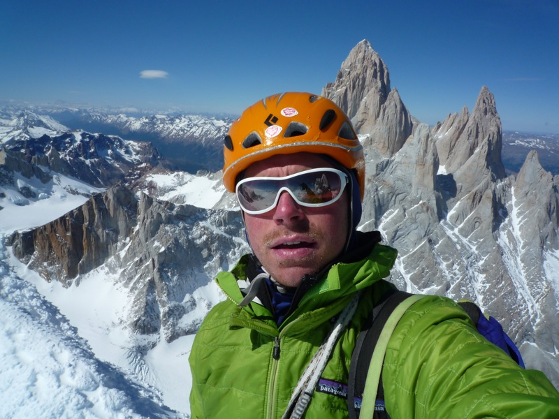 Colin Haley: Self portrait on the summit, with Fitz Roy and Poincenot behind., 153 kb